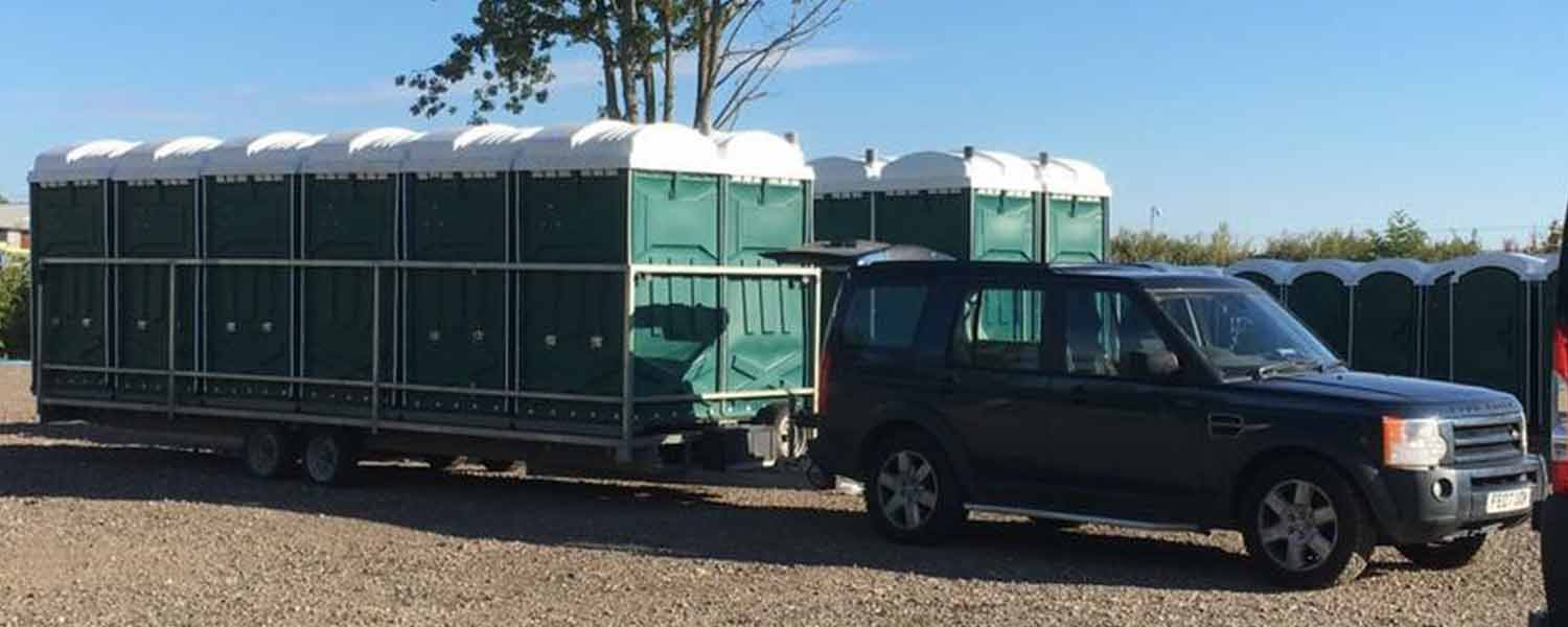 Any occasion green event toilets on trailer being towed