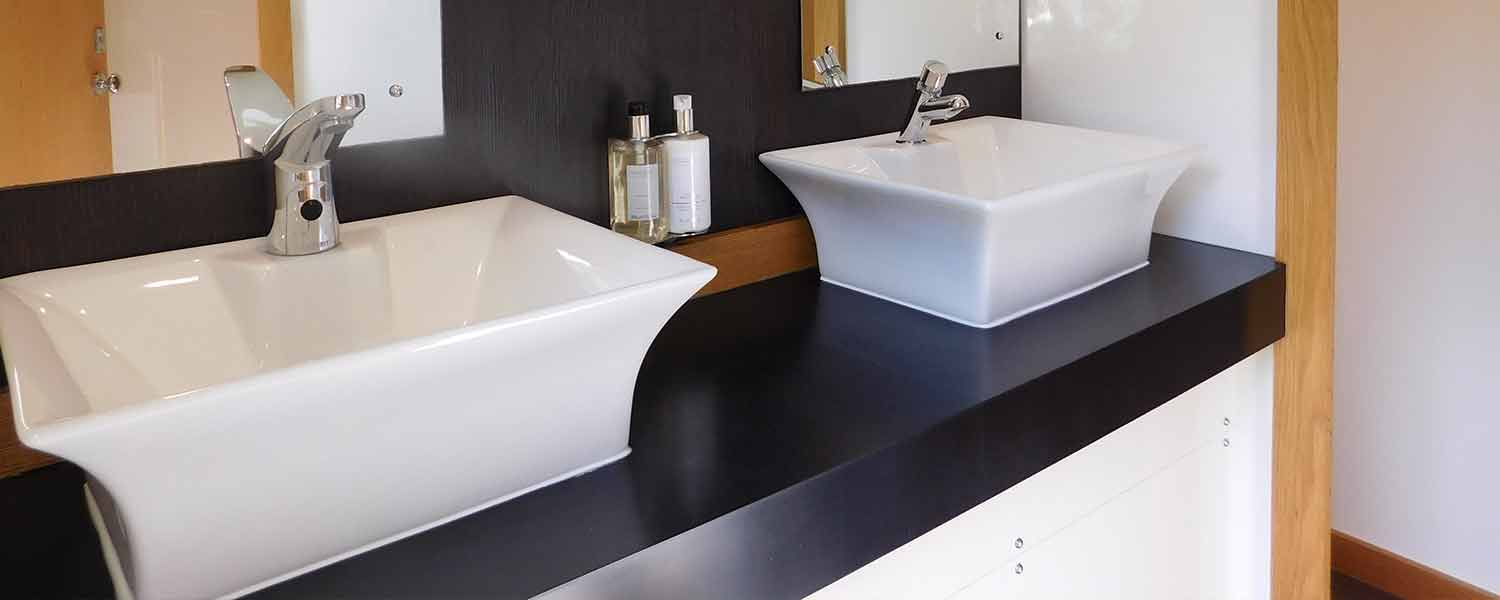 White sinks and mirrors inside any occasion luxury toilet hire