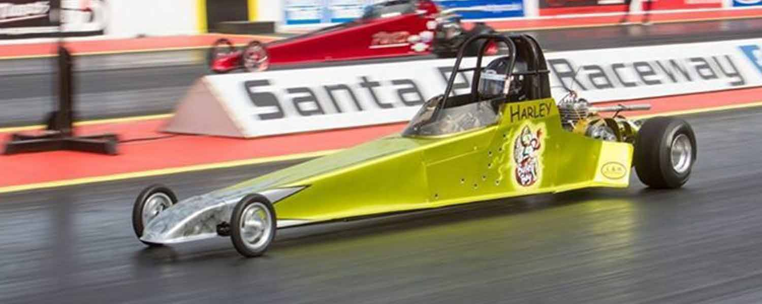 Gold drag car raceing at Santa pod